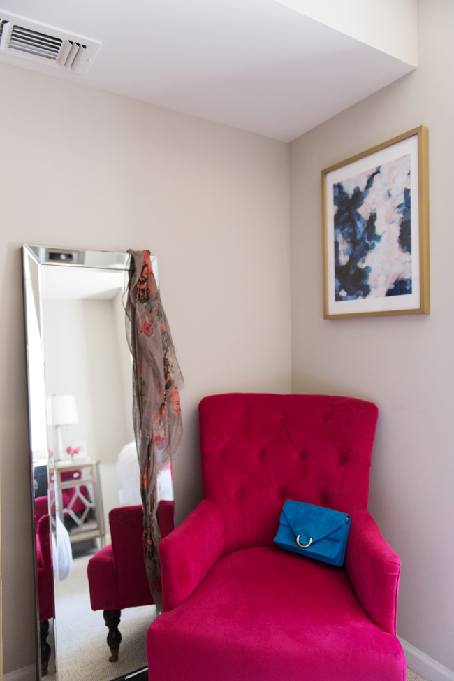 pink world market chair, kirklands beveled mirror, styling area, blogger apartment tour