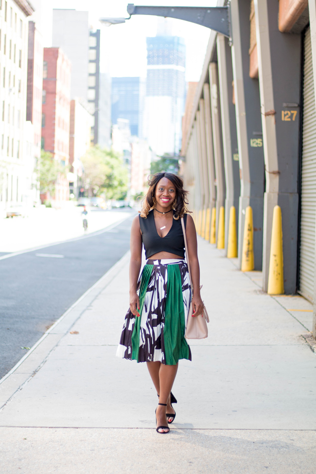 D.C. blogger Alicia Tenise styles a Zara Crop Top, Chicwish Pleated Midi Skirt, Steve Madden Block Heels and Prada Bag for New York Fashion Week