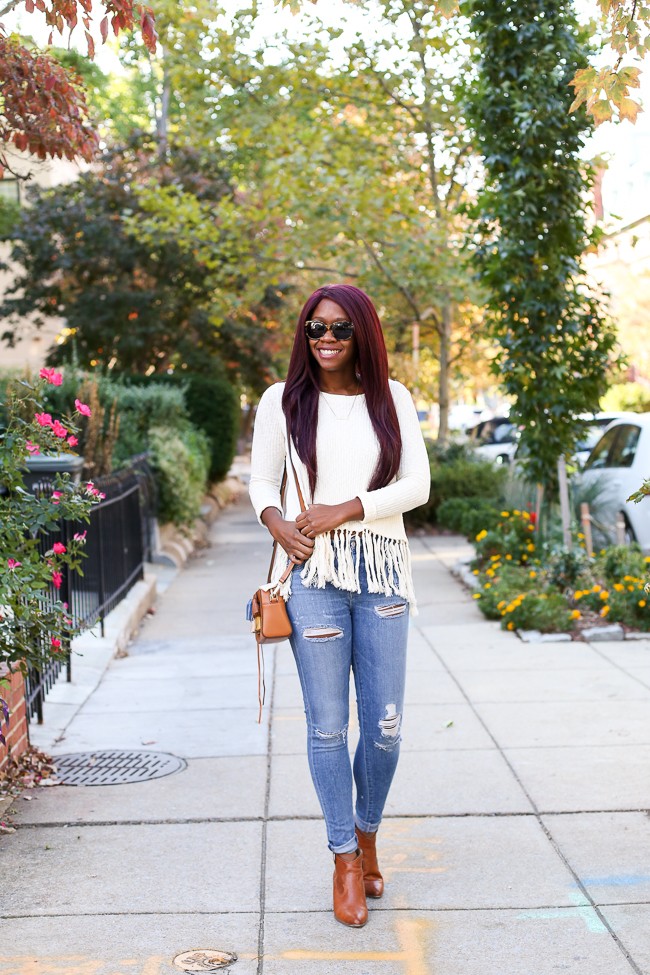 D.C. blogger Alicia Tenise styles the Tassled Mala Pullover from Anthropologie and Distressed A Gold E Jeans