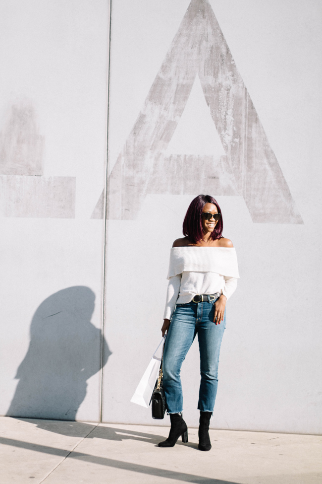 D.C. blogger Alicia Tenise styles the Aerie Off the Shoulder Sweater, Vince Camuto Sendra Boot, Crop Flare Jeans