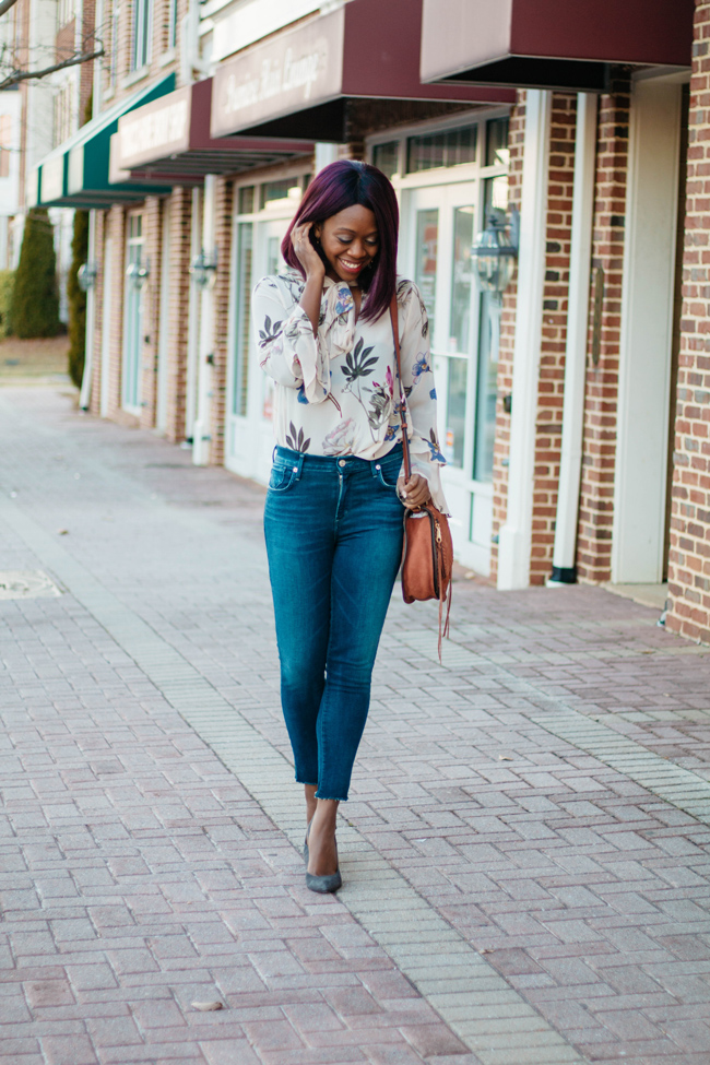 D.C. blogger Alicia Tenise wears the 19 Cooper Sheer Floral Tie Neck Bell Sleeve Blouse from South Moon Under