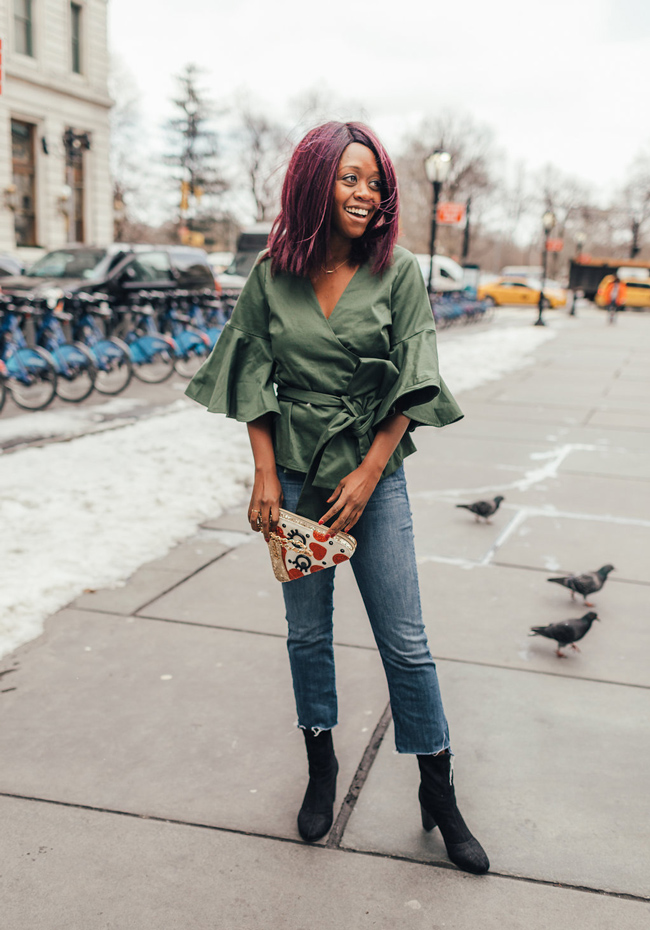 D.C. Blogger styles the Alexis Green Kiera Wrap Top, Mother Insider Crop Denim, Vince Camuto Sendra Bootie, and Betsey Johnson Say Cheese Pizza Slice Crossbody