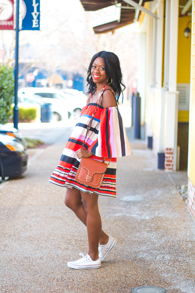 D.C. blogger Alicia Tenise styles the Nicholas Amalfi Stripe Dress from Rent the Runway