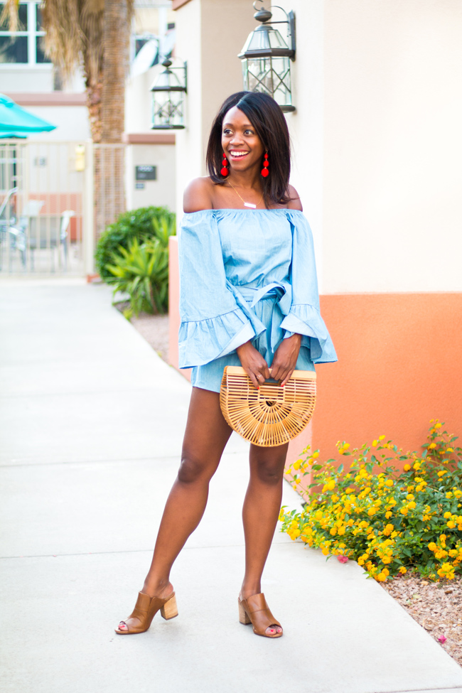 Philadelphia Based Fashion Blogger Alicia Tenise styles the Lioness Del Rio Off the Shoulder Chambray Romper