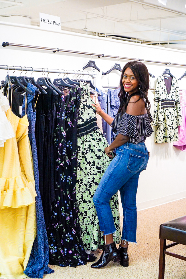 Washington DC fashion blogger Alicia Tenise attends AmericasMart Atlanta October Apparel Week and wears a ruffle one sleeve top, cropped flare denim, and patent leather booties.
