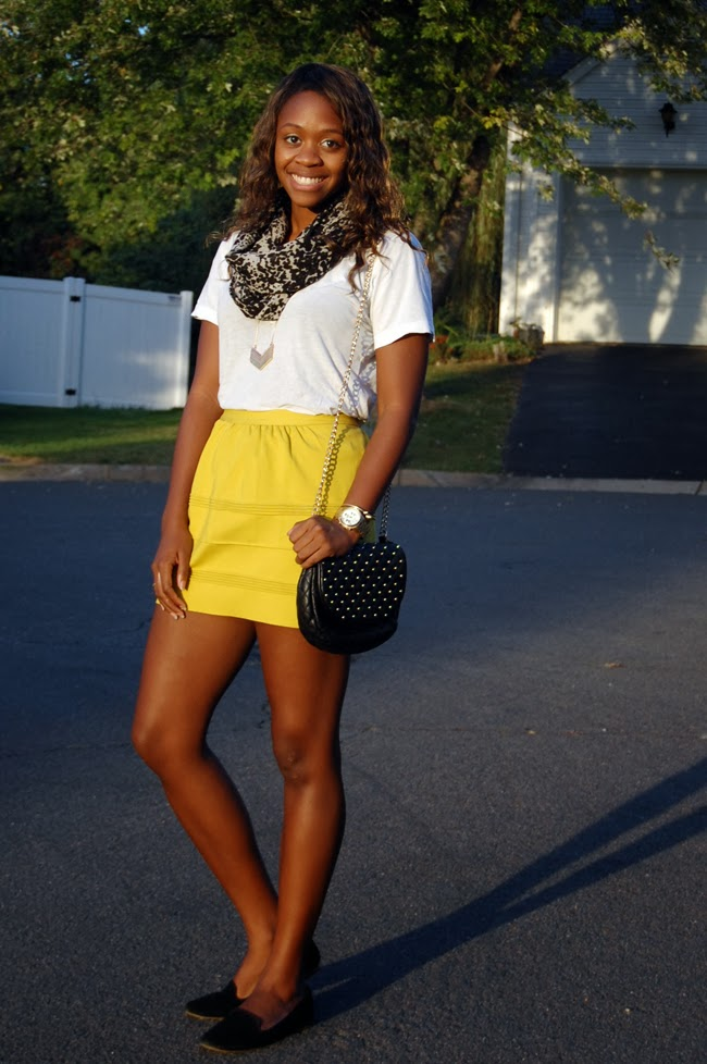 5b73c242a7df I would dress down the skirt with a casual v-neck tee and add a printed  scarf to jazz this look up.