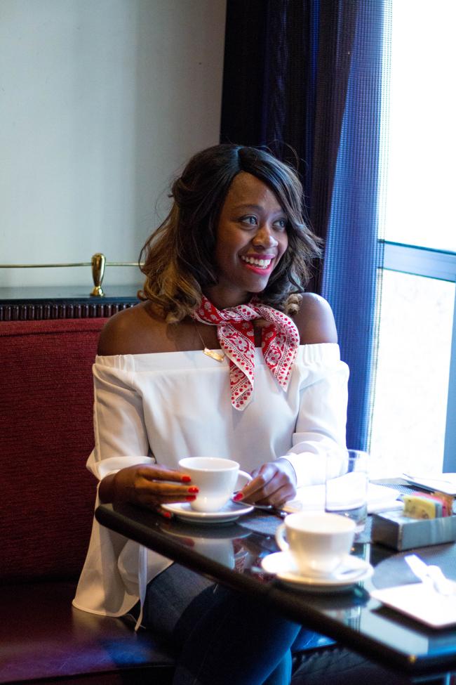 D.C. travel blogger Alicia Tenise in Sofitel NYC's restaurant during NYFW