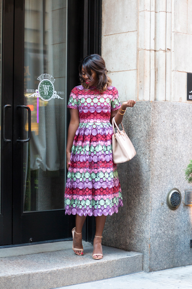 Rent the Runway Review featured by top US fashion blogger Alicia Tenise; Image of a woman wearing midi lace dress.