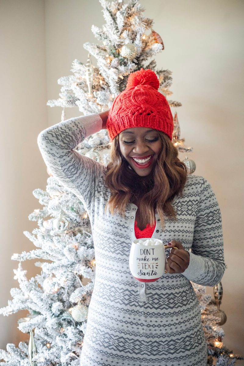 Black Friday and Cyber Monday Sales featured by top DC life and style blog, Alicia Tenise: picture of a woman in front of a Christmas tree, wearing a red pompom knit hat, a Christmas cardigan