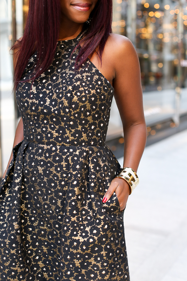 Baublebar Billow Cuff| The Perfect gold holiday cocktail dress featured by top Virginia fashion blogger, Alicia Tenise: picutre of a woman wearing a Rent the Runway dress, Steve Madden sandals, Kendra Scott earrings and rings and Baublebar bracelet