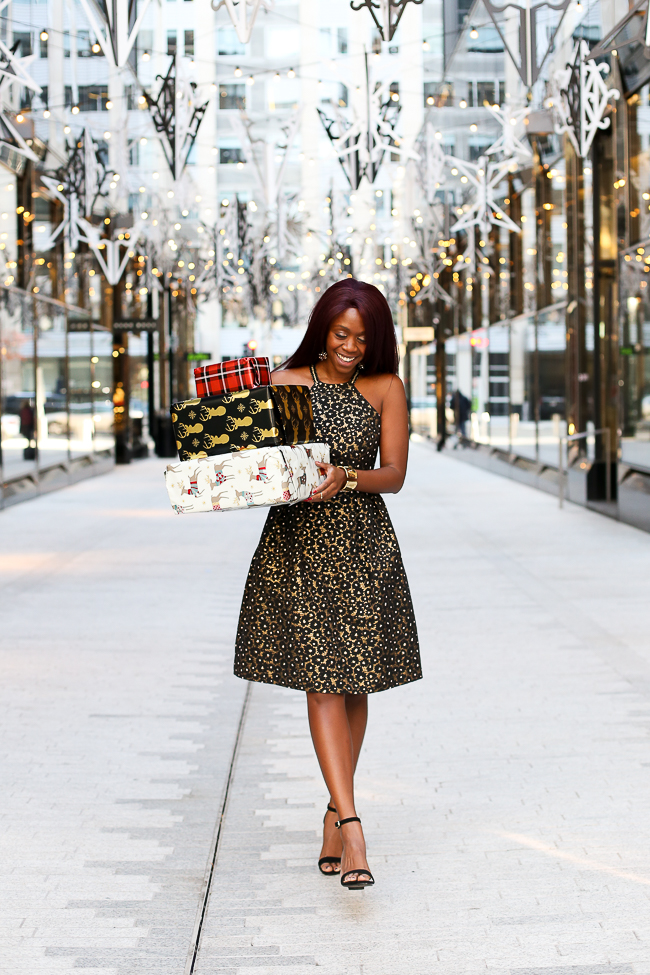 What to Wear to a Holiday Party| The Perfect gold holiday cocktail dress featured by top Virginia fashion blogger, Alicia Tenise: picutre of a woman wearing a Rent the Runway dress, Steve Madden sandals, Kendra Scott earrings and rings and Baublebar bracelet