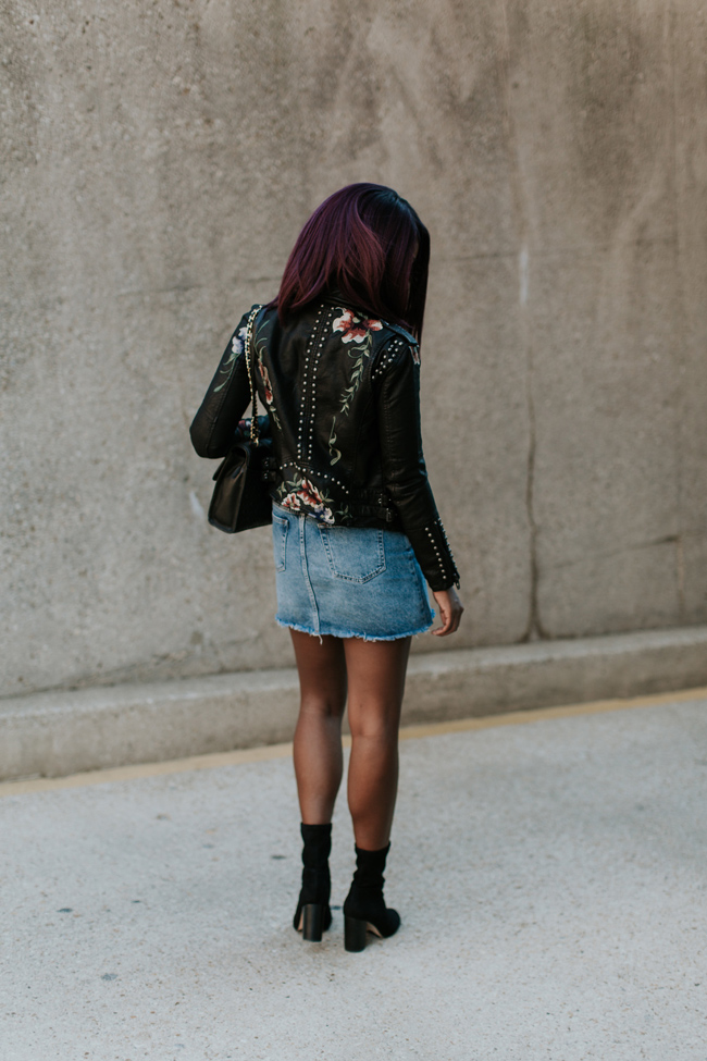 D.C. blogger Alicia Tenise styles an embroidered leather jacket and denim mini skirt