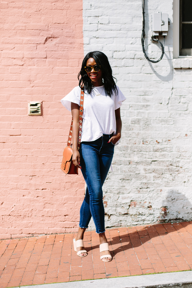 D.C. blogger Alicia Tenise wears the Endless Rose Ruffle Tee, A Gold E Raw Hem Denim and Dolce Vita Mules from South Moon Under