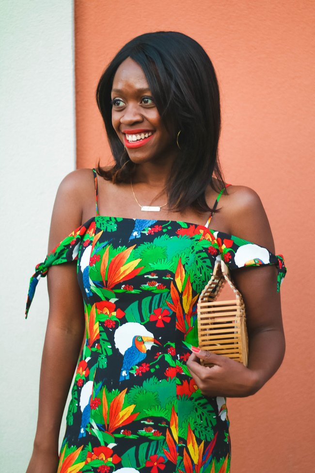 Rent the Runway Review featured by top US fashion blogger Alicia Tenise; Image of a woman wearing tropical vacation dress.