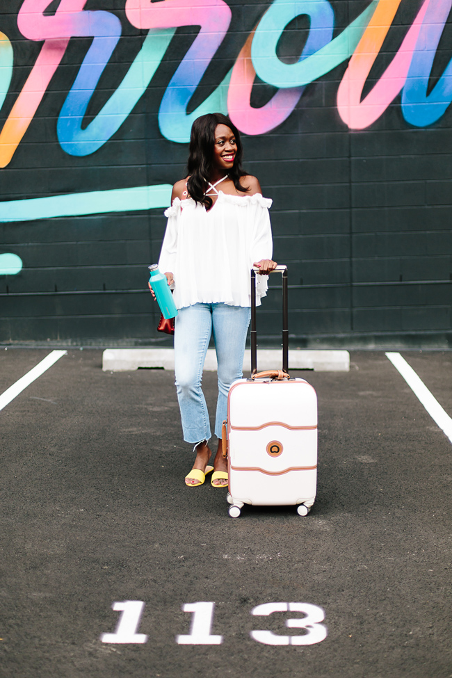 Blogger Alicia Tenise styles the Chicwish Time for Goofing Off Cold Shoulder Top and Madewell Cali Demi-Boot Jeans