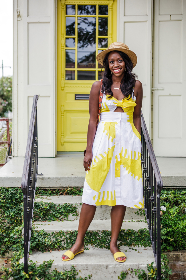 Rent the Runway Review featured by top US fashion blogger Alicia Tenise; Image of a woman wearing yellow sundress.