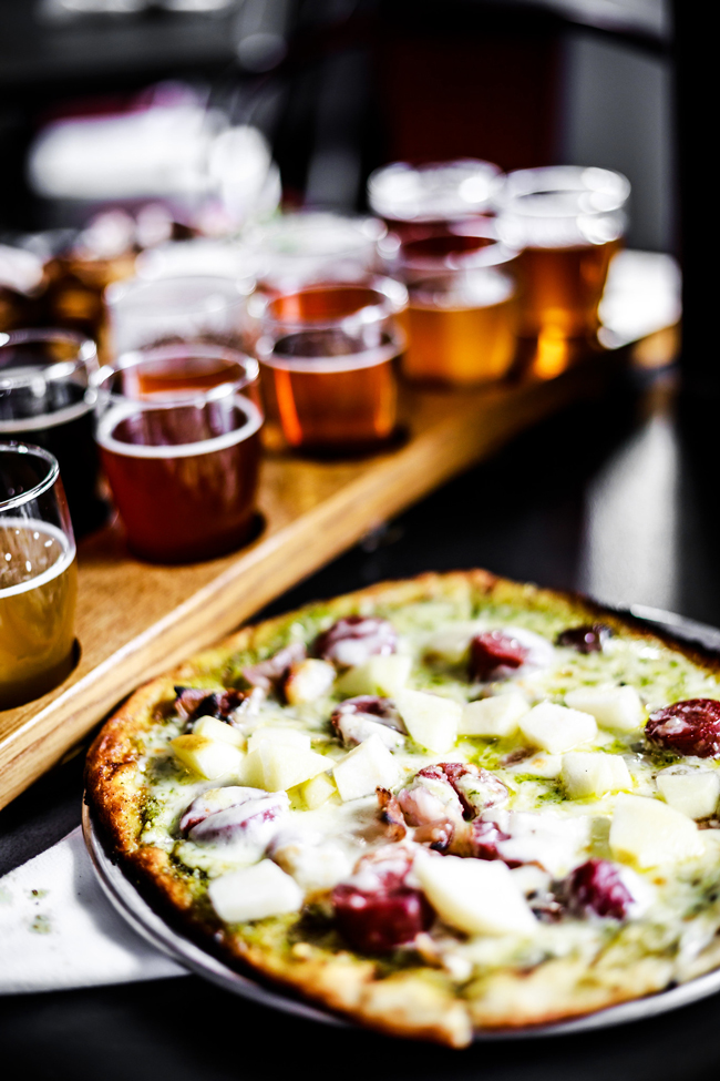 Big Slide Brewery Flights and Pizza - 48-Hour Travel Guide: Things to Do in Lake Placid by Washington DC travel blogger Alicia Tenise