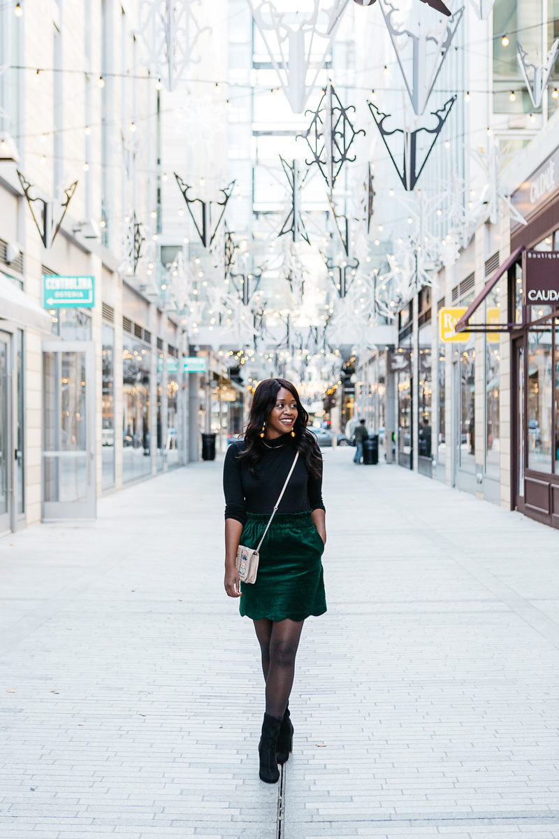 What to Wear to a Daytime Work Holiday Party | Christmas in Washington D.C. by popular Washington D.C. life and style blogger, Alicia Tenise: image of a woman walking through a shopping center.