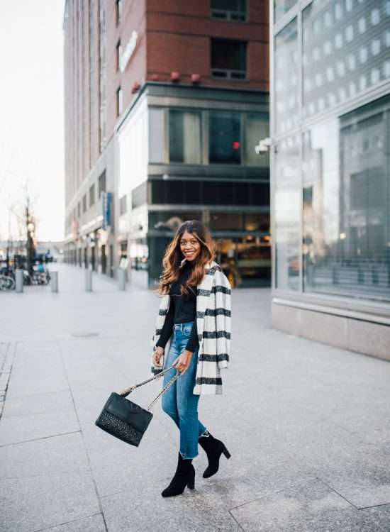 Washington DC Style Blogger wears a buffalo plaid checked coat, cropped flare denim, and sock boots - NYFW for the Right Reasons by popular DC style blogger Alicia Tenise