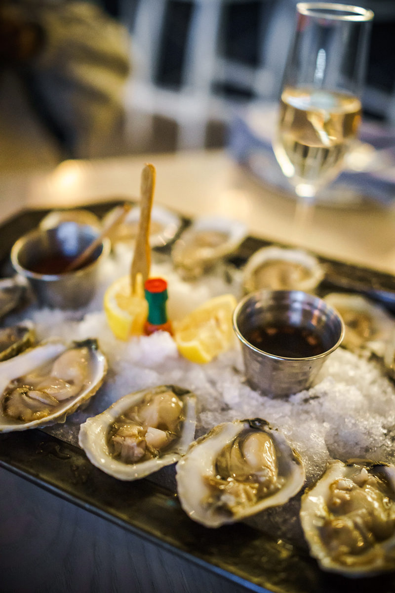 Hummingbird Raw Bar Oysters - Hotel Indigo Old Town Alexandria review by popular DC blogger Alicia Tenise