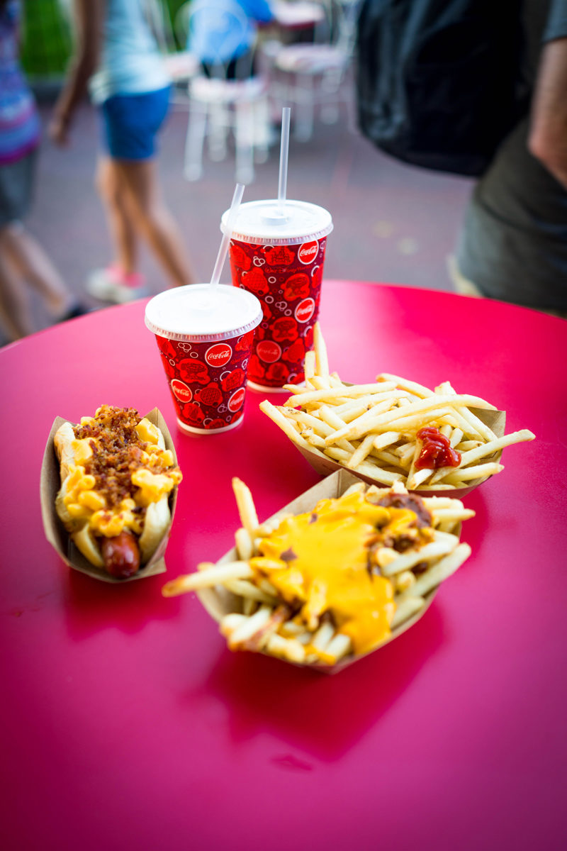 Mac n Cheese Hot Dog at DIsney's Magic Kingdom - Disney World For Adults by popular DC travel blogger Alicia Tenise