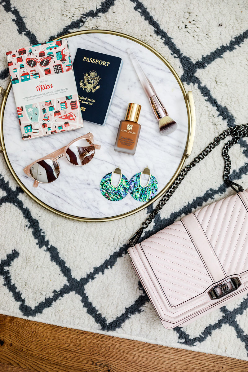 Travel Packing Beauty Tips - 4 Travel Beauty Products I Can't Live Without by popular travel blogger Alicia Tenise