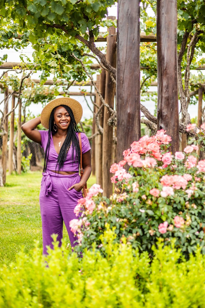 Shopbop Sale featured by top US fashion blogger Alicia Tenise; Image of a woman wearing purple outfit and Brixton Joanna hat.