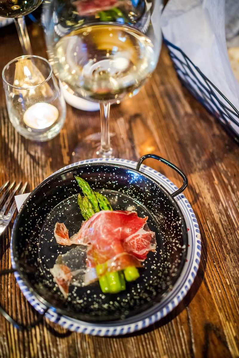 Steamed Asparagus Wrapped in Cinco Jotas Jamon Imberico de Bellota - Fun at the Williamsburg Taste Festival featured by popular DC travel blogger, Alicia Tenise