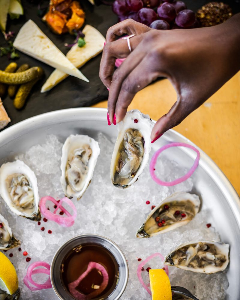 Oysters at Gabriel Archer Tavern - The Ultimate Williamsburg Travel Guide featured by popular DC travel blogger, Alicia Tenise