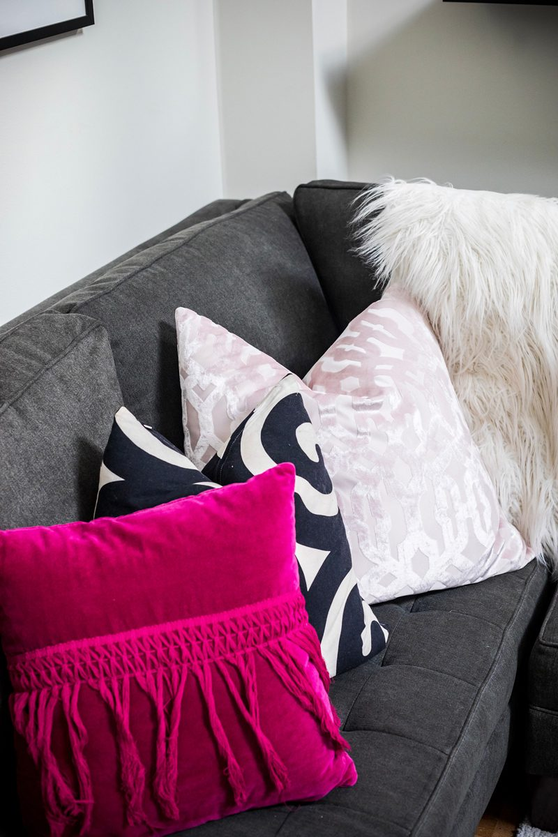 Pink and Neutral Throw Pillows - My Philly Apartment Tour featured by popular Philadelphia blogger Alicia Tenise
