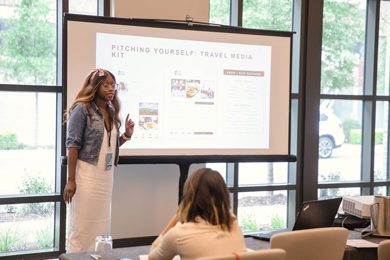 Alicia Tenise presents a travel blog workshop at TBScon in Atlanta - 5 Travel Blogging Tips I Shared at #TBScon featured by popular DC travel blogger Alicia Tenise