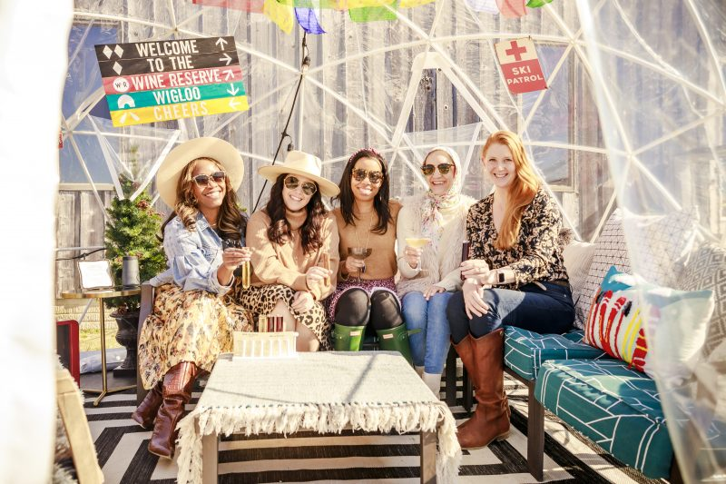 The Wine Reserve at Waterford |Virginia Wineries by popular D.C. travel blogger, Alicia Tenise: image of Alicia Tenise sitting with a group of women.