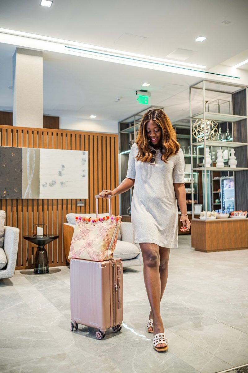 Calpak Rose Gold Metallic Luggage, Vera Bradley Straw Beach Tote - 10 Things I Always Pack for NYFW featured by popular Virginia fashion blogger Alicia Tenise