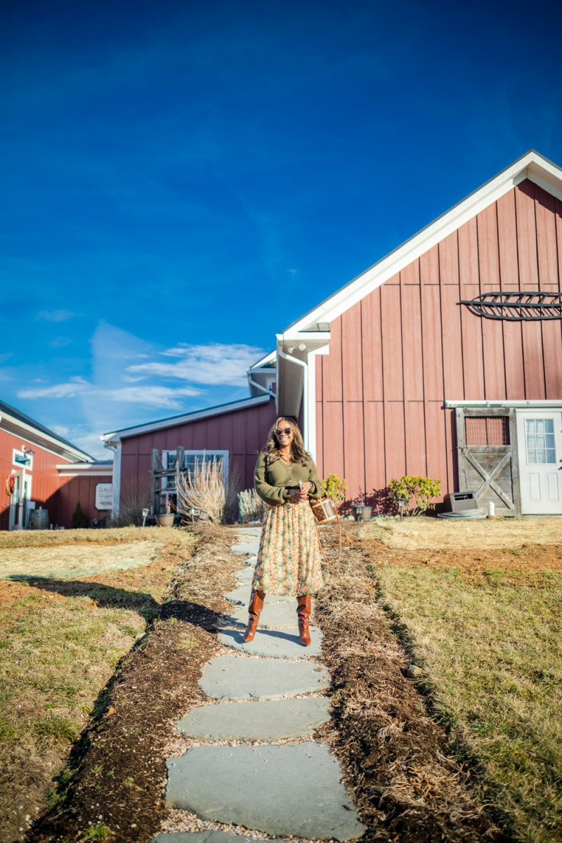 Slater Run Vineyards |Virginia Wineries by popular D.C. travel blogger, Alicia Tenise: image of Alicia Tenise standing outside at Slater Run Vineyards.