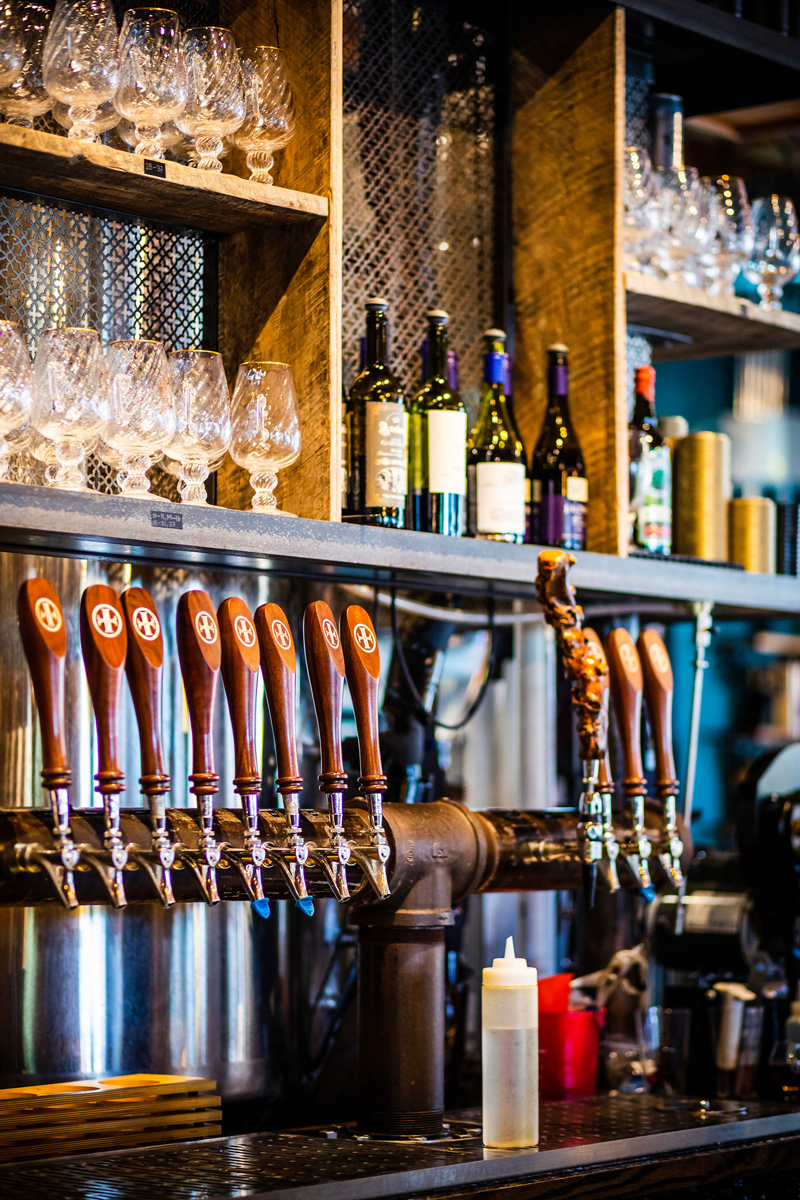 Lazarus Brewing in Austin | The Ultimate Guide of Things to Do in Austin TX featured by top Virginia travel blog Alicia Tenise | Things to do in Austin by popular LA travel blogger, Alicia Tenise: image of beer on tap.