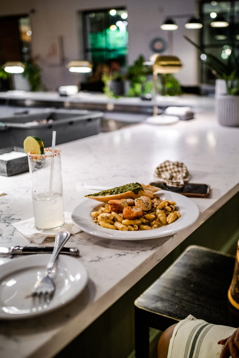 Hank's Austin | Things to do in Austin by popular LA travel blogger, Alicia Tenise: image of a plate of scallops and pasta.