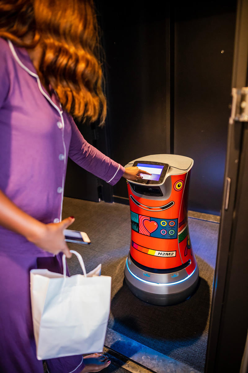 Hotel Monville Robot Room Service | Where to Stay in Downtown Montreal: Hotel Monville featured by top Virginia travel blog Alicia Tenise