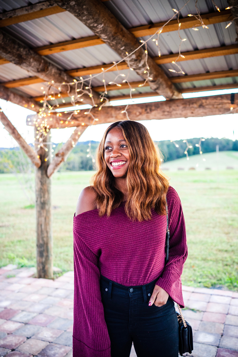 Shopbop Sale Favorites featured by top DC fashion blog, Alicia Tenise: picture of a woman wearing a purple off the shoulder top and black denim skinny jeans
