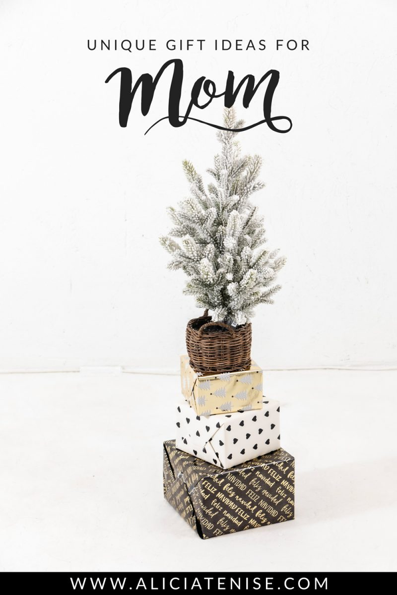 Unique Gift Ideas for Mom | Best Gifts for Mom + Giveaway! by popular Washington D.C. life and style blogger, Alicia Tenise: image of 3 stacked presents with a mini flocked Christmas tree on top.