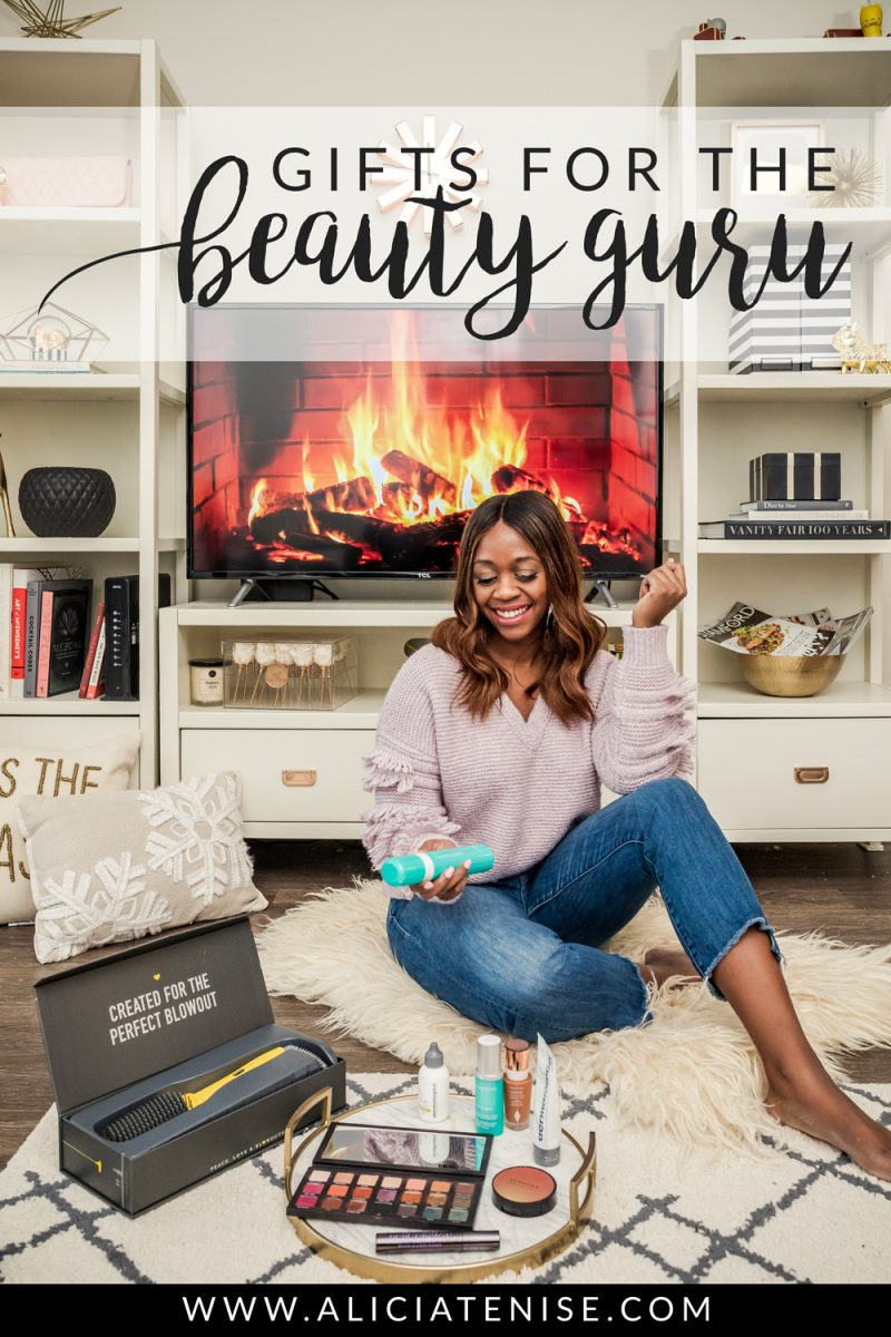Top Beauty Gift Ideas for the Beauty Guru by popular Washington D.C. life and style blogger, Alicia Tenise: image of a woman sitting on the floor with various beauty products.