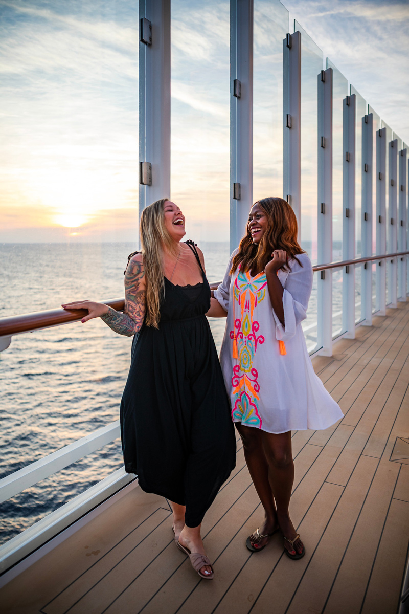Travel bloggers Alicia Tenise and Get Lost With Jackie on the Celebrity Edge | Top DC Travel Blogger Alicia Tenise exclusively reviews the brand new Celebrity Edge cruise ship: image of 2 women walking on the Celebrity Edge deck