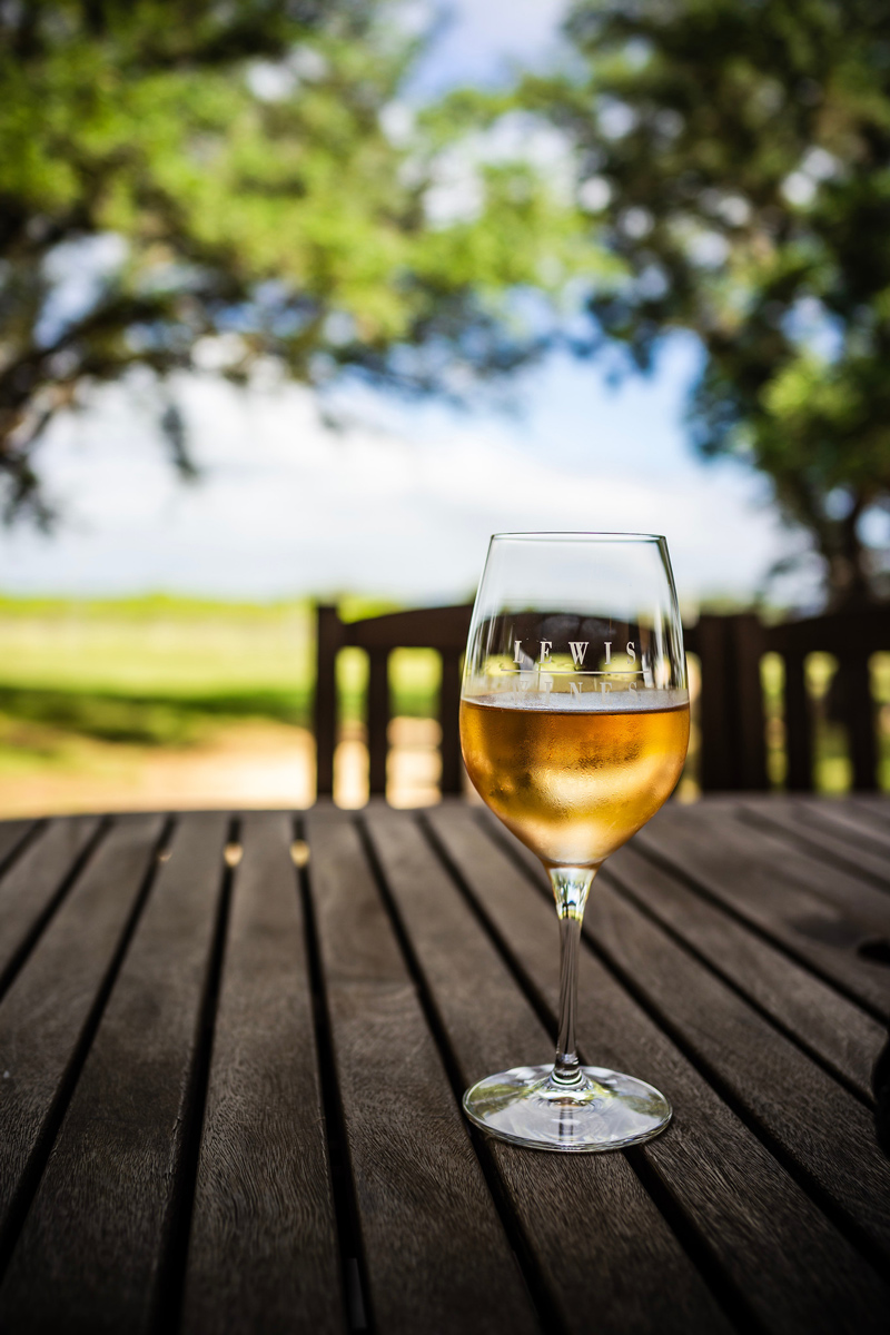 The Most Popular Blog Posts of 2019 by popular Washington DC life and style blogger, Alicia Tenise: image of a glass of white wine.