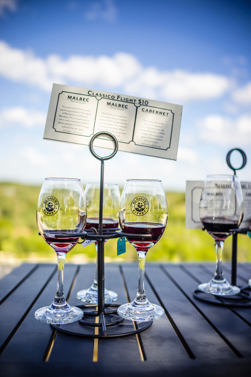 El Gaucho Winery | Duchman Family Winery | Salt Lick Cellars | The Best Wineries in Texas Hill Country featured by top US travel blogger, Alicia Tenise: Image of wine glasses at Duchman Winery