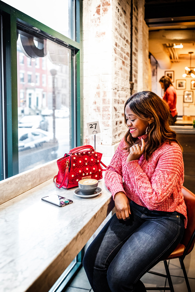 Casual Valentine's Day Outfit featured by top US fashion blogger Alicia Tenise; Image of woman wearing C/MEO Collective sweater, Madewell jeans, Zac Zac Posen bag, Kendra Scott earrings and Charlotte Tilbury 'The Queen' lipstick.