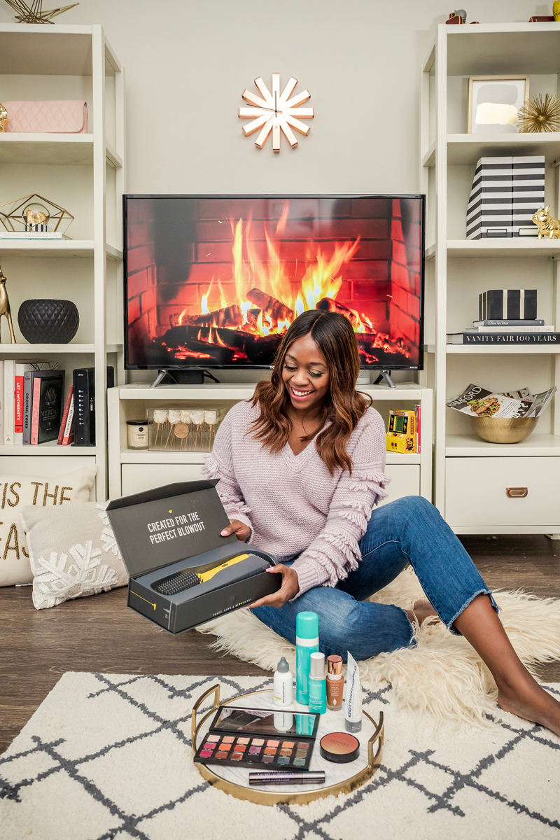 Best Beauty Products of 2018 featured by top US beauty blogger Alicia Tenise; Image of a woman sitting in her living room.