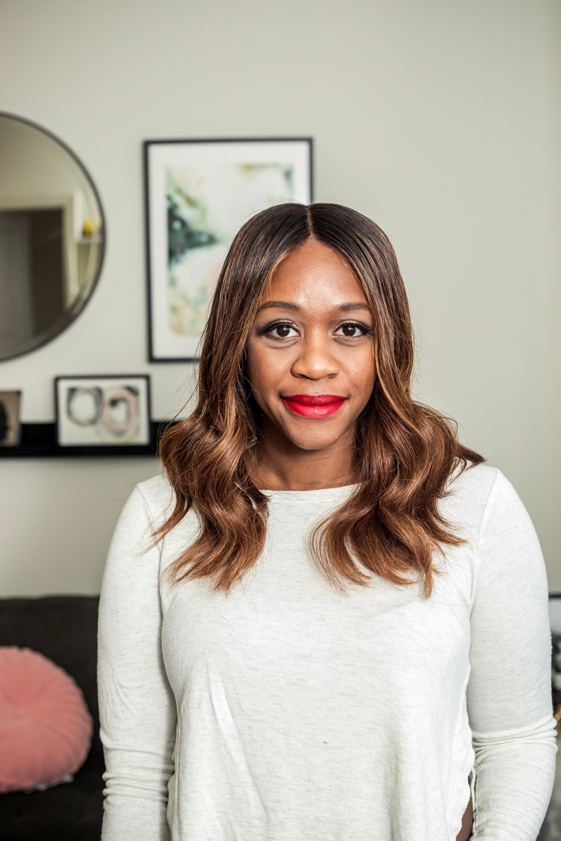 Lipsticks for Dark Skin Tones featured by top US beauty blogger Alicia Tenise; Image of a woman wearing Charlotte Tilbury Matte Revolution Lipstick in 'The Queen'.