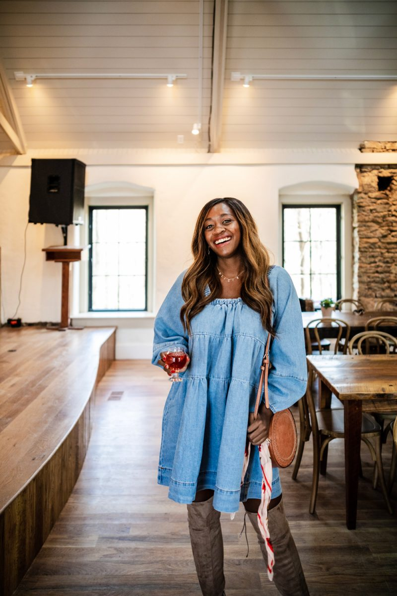 Shopbop Sale - Free People Blue Jean Babydoll Dress | ShopBop Sale by popular DC fashion blogger, Alicia Tenise: image of a woman wearing over the knee boots and a ShopBop Free People Blue Jean Babydoll Dress.