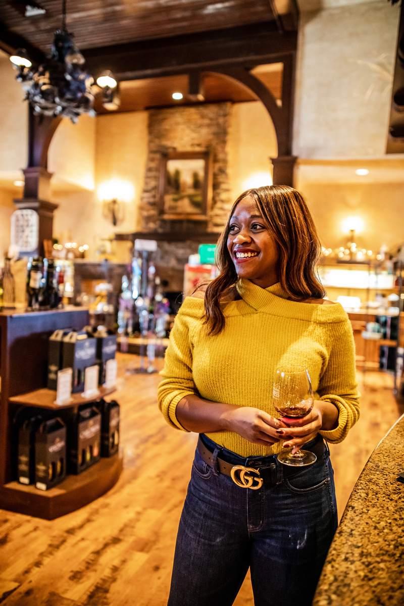 Childress Vineyards | The Most Popular Blog Posts of 2019 by popular Washington DC life and style blogger, Alicia Tenise: image of a woman holding a glass of wine.