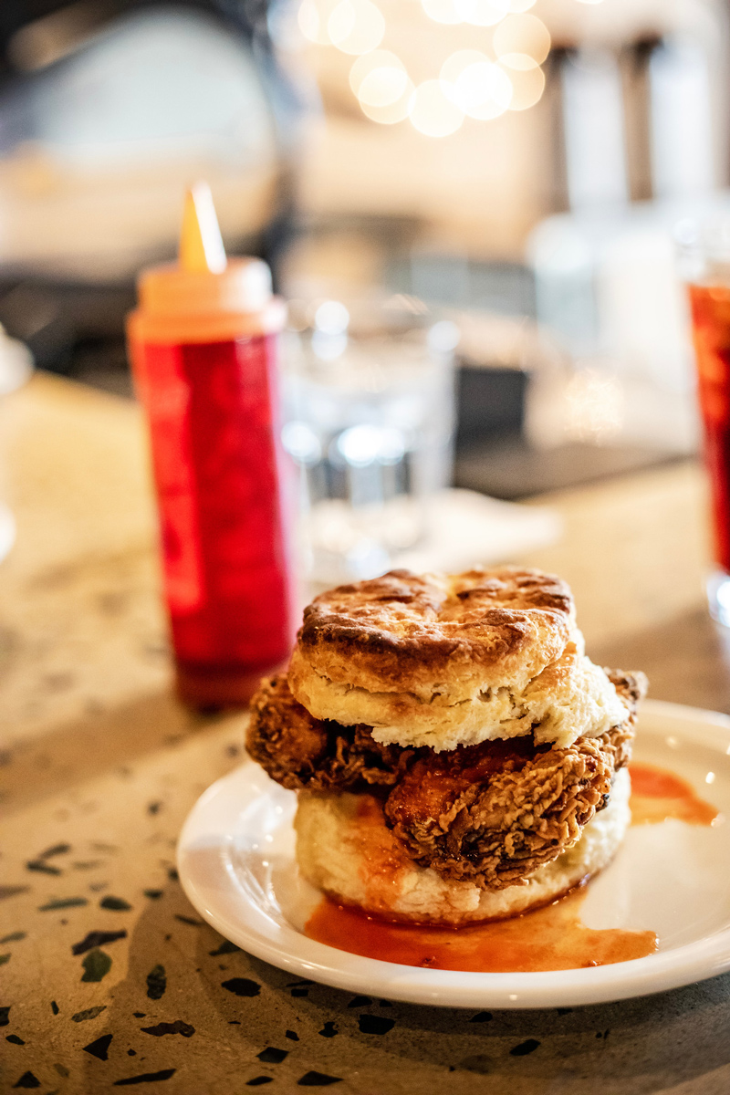 Krankies Coffee Breakfast Biscuit Sandwich | The Most Popular Blog Posts of 2019 by popular Washington DC life and style blogger, Alicia Tenise: image of a chicken and biscuit sandwich.