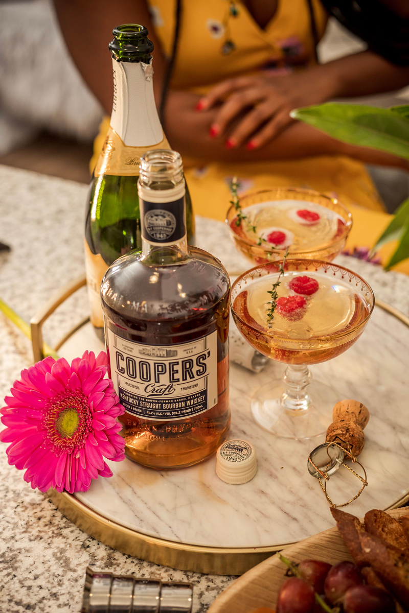 Best Spring Cocktail: Champagne Bourbon Cocktail recipe featured by top US life and style blogger, Alicia Tenise